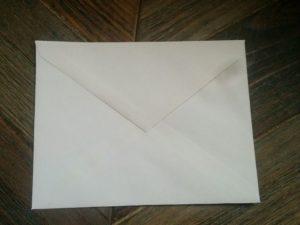 scrapbooking on a budget using envelopes for pockets or altered envelopes
